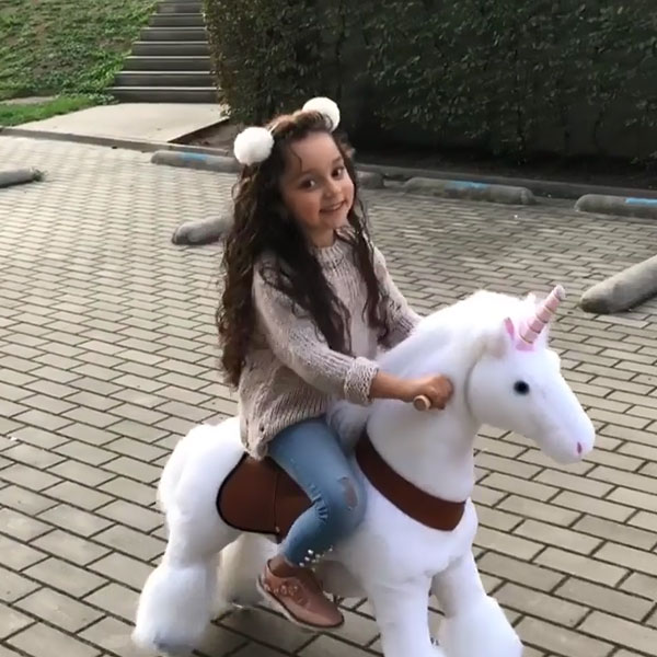 Happy with my unicorn ride on toy