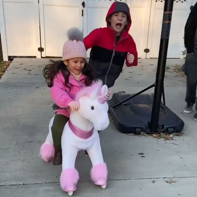 Surprise! Got her unicorn ride on toy!